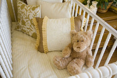 Baby crib and bear. Stock Photos