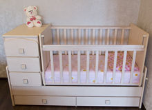 Baby crib. Bed for child.  Stock Photos