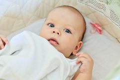Baby in crib Stock Images