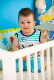 Baby on crib at home Royalty Free Stock Photo