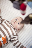 Baby in crib looking at toys Royalty Free Stock Photo