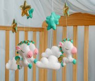 Baby crib mobile - kids toys, on white background stock photography