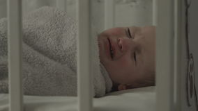 Baby cries because he does not want to sleep. stock video footage
