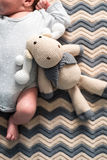 Baby on a  crocheted blanket Stock Images