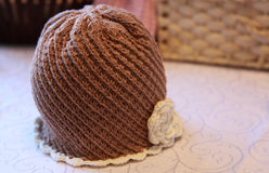 Baby crocheted hat for boy and girl, on the table Royalty Free Stock Images