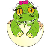 Baby crocodile girl with pink bow Royalty Free Stock Photos