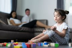 Baby cry and sit in living room with her mom and mother. Kid, girl and family concept royalty free stock photography