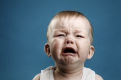 Baby crying. Photo of nine month baby crying, isolated Royalty Free Stock Image
