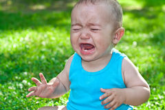 Baby crying stock photos