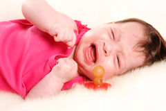 Baby is crying. Baby girl was crying, asking the nipple stock photography