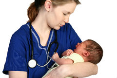 Baby Crying. Female nurse consoling a crying newborn baby over white background Stock Photography