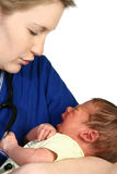 Baby Crying. Female nurse consoling a crying newborn baby over white background Stock Photos