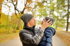 Baby crying in arms of his father in park.  royalty free stock photography