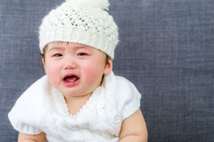 Baby crying. Asian Baby girl crying at home Stock Photography