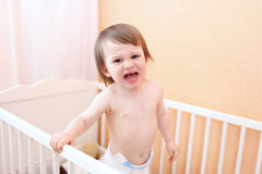 Baby crying in bed. Crying baby dont want to sleep Royalty Free Stock Photo