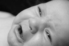 Baby Crying - Black and White. Black and white photo of a baby crying stock photo
