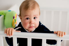 Baby crying in the crib Stock Photos