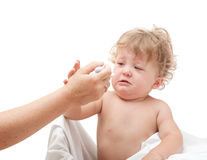Baby is crying and does not want to eat from a spoon, which give Royalty Free Stock Photos