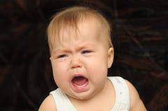 Baby crying emotionally Stock Images