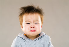 Baby crying. With gray background stock images