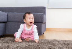 Baby crying at home Stock Photo