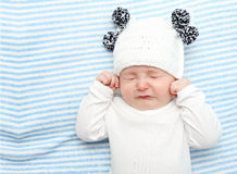 Baby crying. Little baby crying on bed Royalty Free Stock Photography