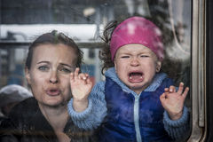 Baby crying with mother royalty free stock photo