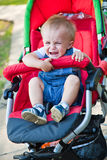 A baby is crying in the pram Royalty Free Stock Images
