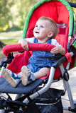 A baby is crying in the pram Stock Images