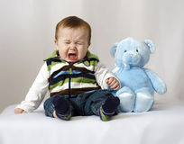 Baby crying with Teddy Bear Royalty Free Stock Photo