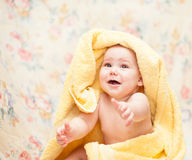 Baby crying in a yellow towel Royalty Free Stock Photos