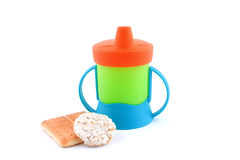 Baby cup with biscuit Royalty Free Stock Images
