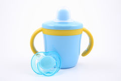 Baby cup and pacifier Stock Photo