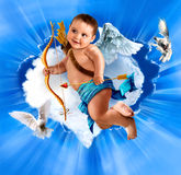 Baby cupid with angel wings. Sitting on a cloud stock photo