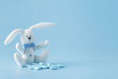 Baby cure concept. Kids pills with cute toy Stock Images