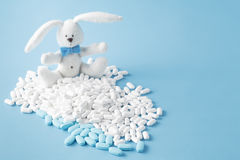 Baby cure concept. Kids pills with cute toy Stock Image
