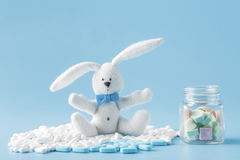 Baby cure concept. Sweets, pills and kid toy Royalty Free Stock Photo