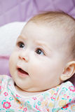 Baby with curious facial expression Stock Photography