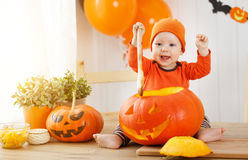 Baby cut  pumpkin for Halloween in kitchen at home Stock Images