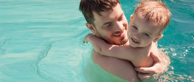 Baby with dad swimming in the pool. Father and son stock images