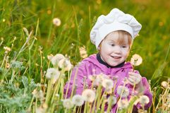 Baby with dandelion Stock Photography
