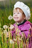 Baby with dandelion Stock Photos