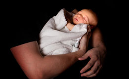 Baby in darkness Stock Image