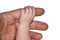 Baby, das Finger hält Stockbild