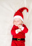 Baby, das in Sankt-Kostüm schläft Stockfotos