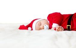 Baby, das in Sankt-Kostüm schläft Lizenzfreies Stockbild