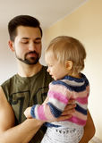 Baby daughter with father Stock Photos