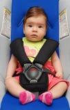 Baby in de autozetel Stock Foto