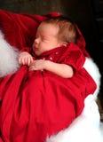 Baby in de Wapens van de Kerstman Stock Foto