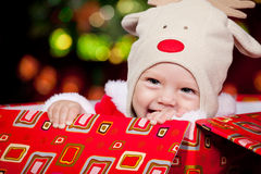 Baby in deer hat Stock Image